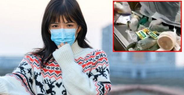 Koronavirüs korkusunun zirve yaptığı Çin'de, market sahipleri brandanın arkasından alışveriş yapıyor